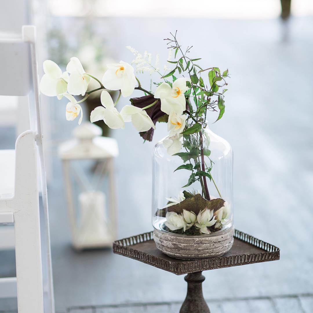 More Aisle Bling @jharperphoto  #aisledecor #terrarium #orchids #theknot #stylemepretty #weddingflowers #getcreative