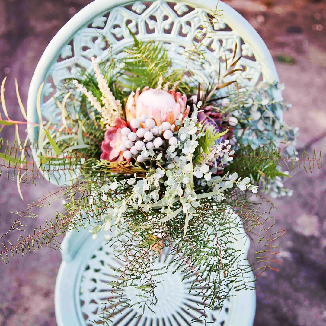 {Bouquet on cool chair} @juliesurettephotography  #flowerartist #prettyflowers #nhweddingflorist #succulents #protea #beoriginal #photoshoot