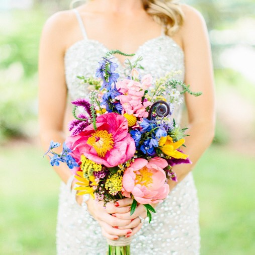 {Simple & sweet} @kellydillonphotography  #wildflowers #bouquet #peonies #nhweddingflorist #lotusstyle #italianfarmhouse #natural #theknot #stylemepretty #prettyflowers #brightcolors