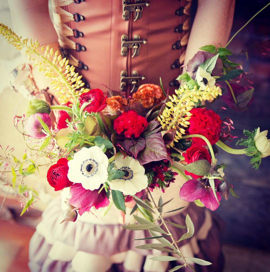 steam {punk} @sagestudiosphotography  #steampunk #steampunkbride #steampunkstyle #corset #bouquet #customdress #awesomeness #beoriginal #anemones #helleborus #cockscomb #ranunculus #photoshoot #flowerartist