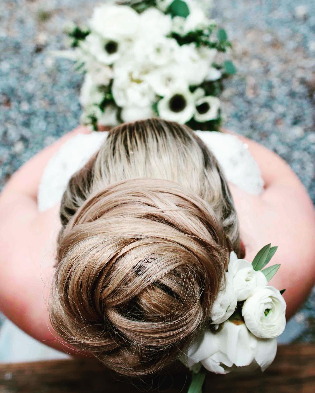 {LOVE this bun} #casagrandephotography  #loveherhair #hairflowers #weddinghair #bouquet #hairdecor #weddingflorist #peonies #casagrandephotography
