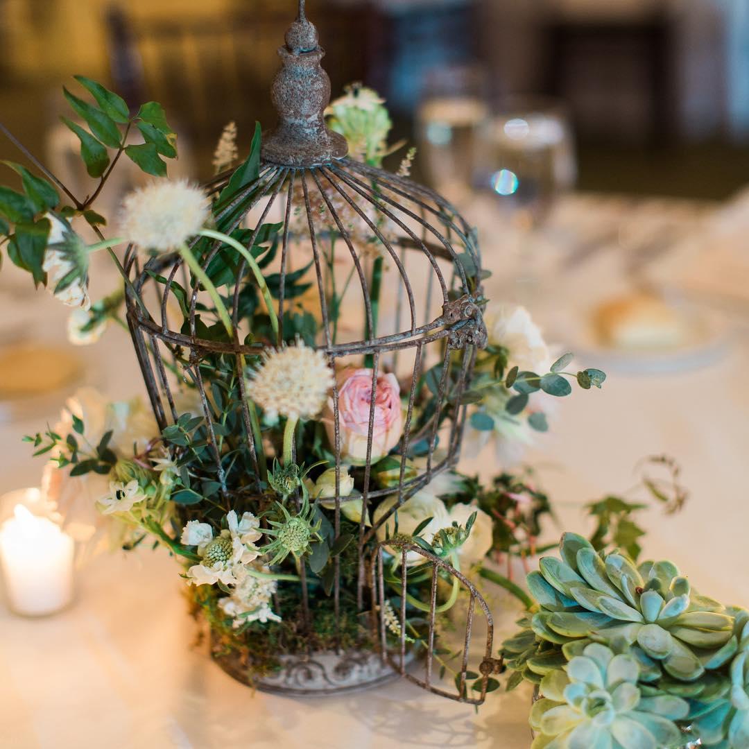 {Table decor} @jharperphoto  #birdcage #centerpiece #succulents #woodland #weddingflowers #theknot #lotusfloraldesigns #rustic #weddingflorist