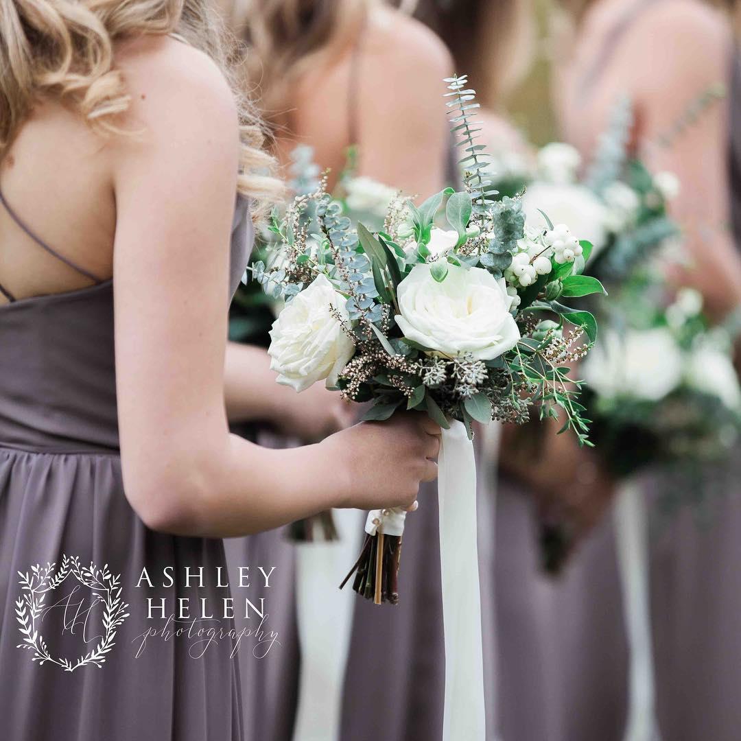 {her girls} @ashleyhelenphotography  #bridesmaids #rusticwedding #nhwedding #barnwedding #weddingflorist #rusticelegance #snowberries  #lotusfloraldesigns #eucalyptus #roses