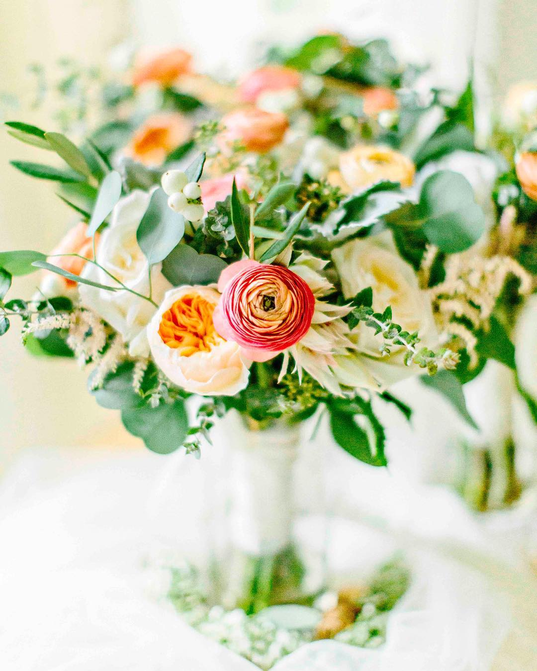 {that ranunculus} photo| @kellydillonphotography  #bouquets #lovely #ranunculus #juliet #coral #peach #capecodwedding #lotusfloraldesigns #weddingflorist #bridebook #bridebookflowers