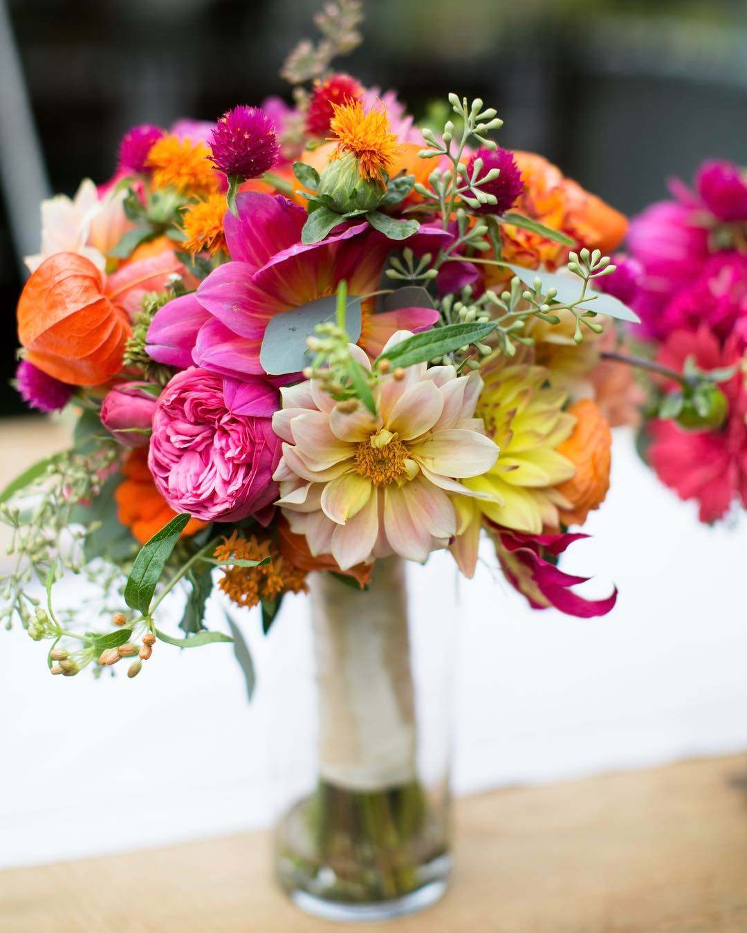 {sweetness} photo | @authenticeyephoto  #bouquet #barnwedding #rusticelegance #dahlias #gardenroses #gomphrena #seededeucalyptus #gloriosa #safflower #ranunculus #coral #pink #orange #lotusfloraldesigns #weddingflorist
