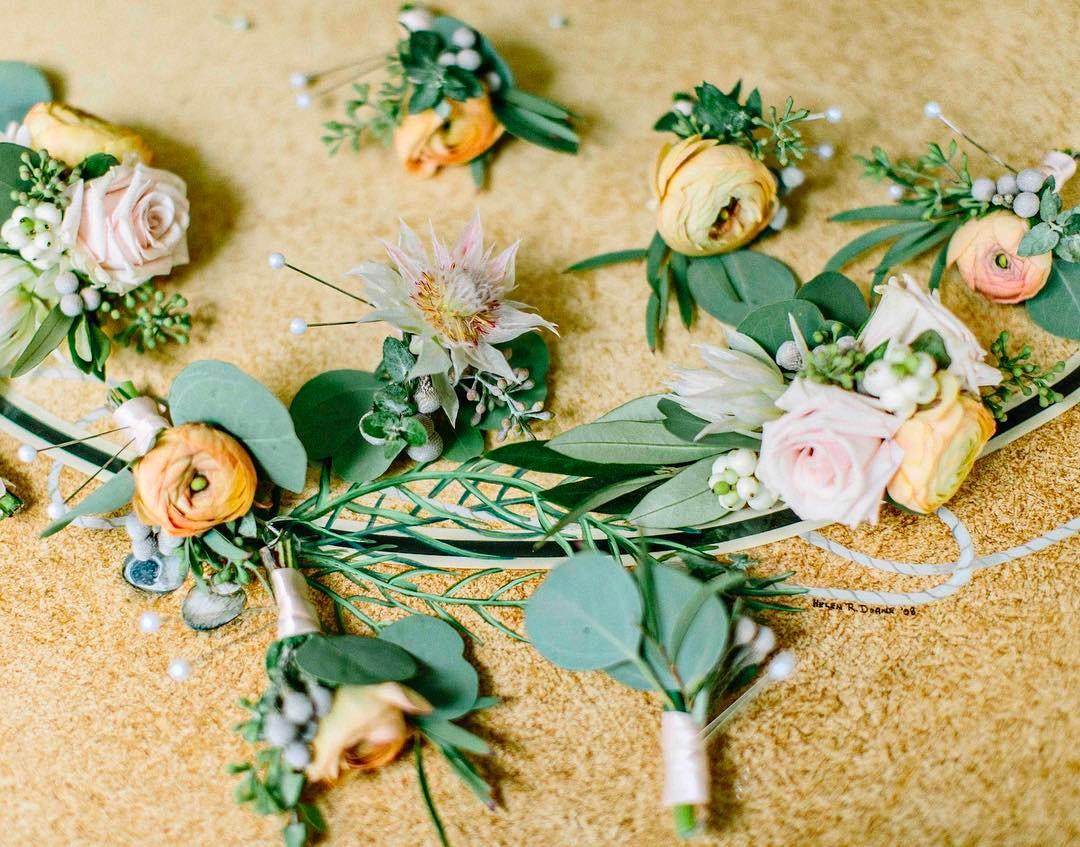 {man bling} photo | @kellydillonphotography  #manflower #boutonniere #mandecor #ranunculus #eucalyptus #blushingbride #blush #peach #flowerartist #weddingflorist #lotusfloraldesigns #flowerlover