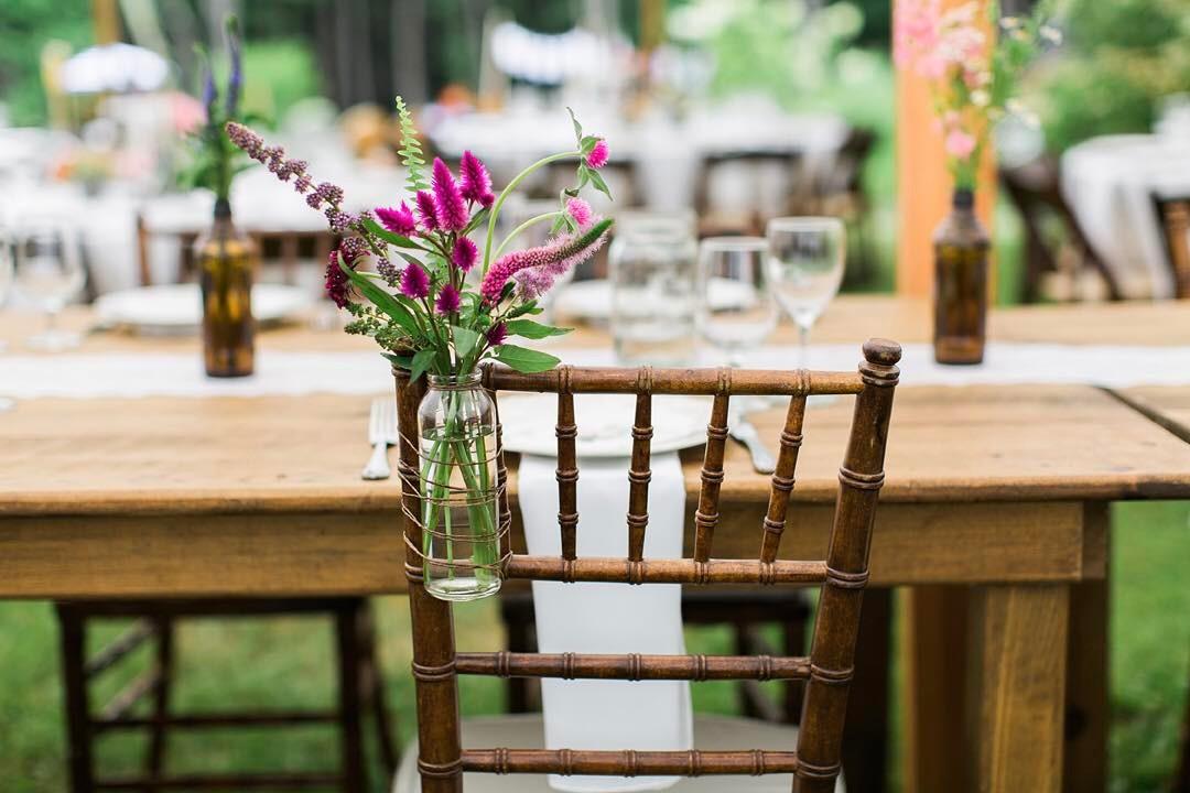 {her chair} photo | @monpetitstudio  #chairdecor #lovely #forher #brideschair #simple #vintage #wildflowers #celosia #gomphrena #veronica #pink #getcreative #lotusfloraldesigns #weddingflorist #love #dinnertime #bridebling #awesomeness #prettyflowers