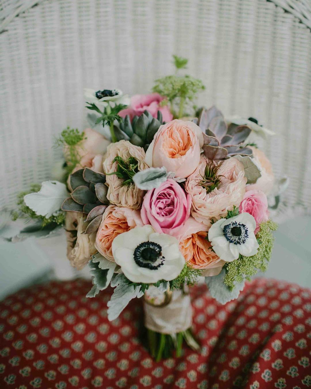 {lovely} photo | @emilydelamater  #bridebling #bouquet #accessory #prettyflowers #barnwedding #kitzfarm #gardenroses #anemones #succulents #lotusfloraldesigns