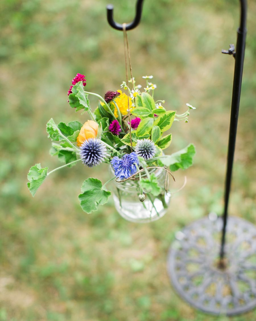 {simple} photo | @monpetitstudio  #aisledecor #shepherdhooks #wildflowers #colorful #prettyflowers #simple #lovely #lotusfloraldesigns #weddingflorist