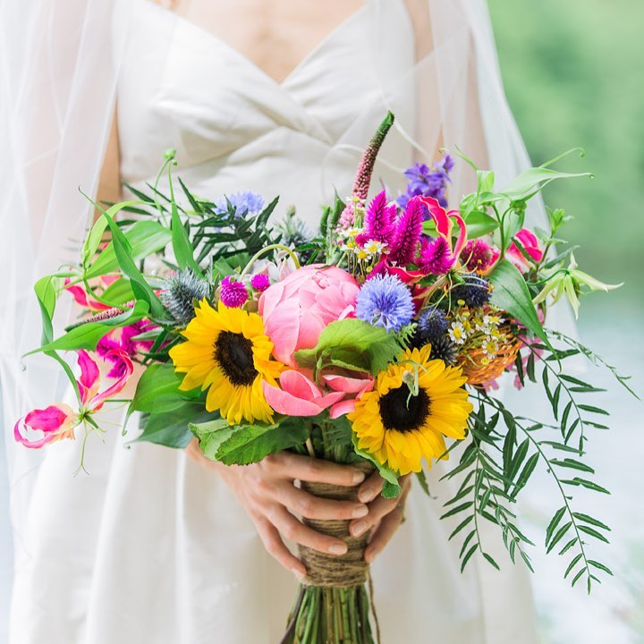 This lovely is featured on @theknot today!! photo | @monpetitstudio  #prettyflowers #bridebling #colorful #bouquet #peonies #sunflowers #thistle #lotusfloraldesigns #weloveflowers #weddingflorist #theknot #theknotrealweddings