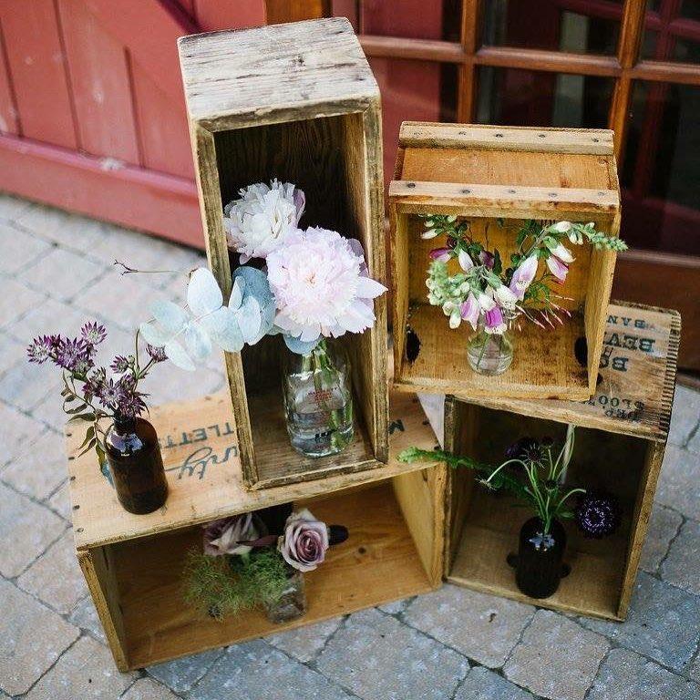 {stacked vintage boxes always look cool} photo | @bethanyanddan  #rustic #barnwedding #rusticdecor #woodenboxes #vintage #vintagestyle #rusticwedding #lotusfloraldesigns #weddingflorist #weloveflowers