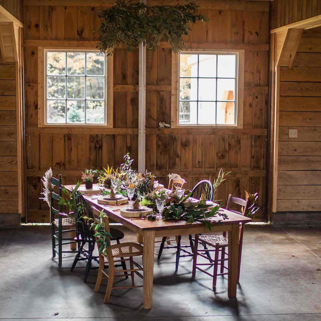 {barn decor} photo | @abphotonh  #rustic #rusticwedding #barnwedding #tablescape #chairdecor #hangingwreath #olivebranch #photoshoot #getcreative #lotusfloraldesigns #weddingflorist #lovely