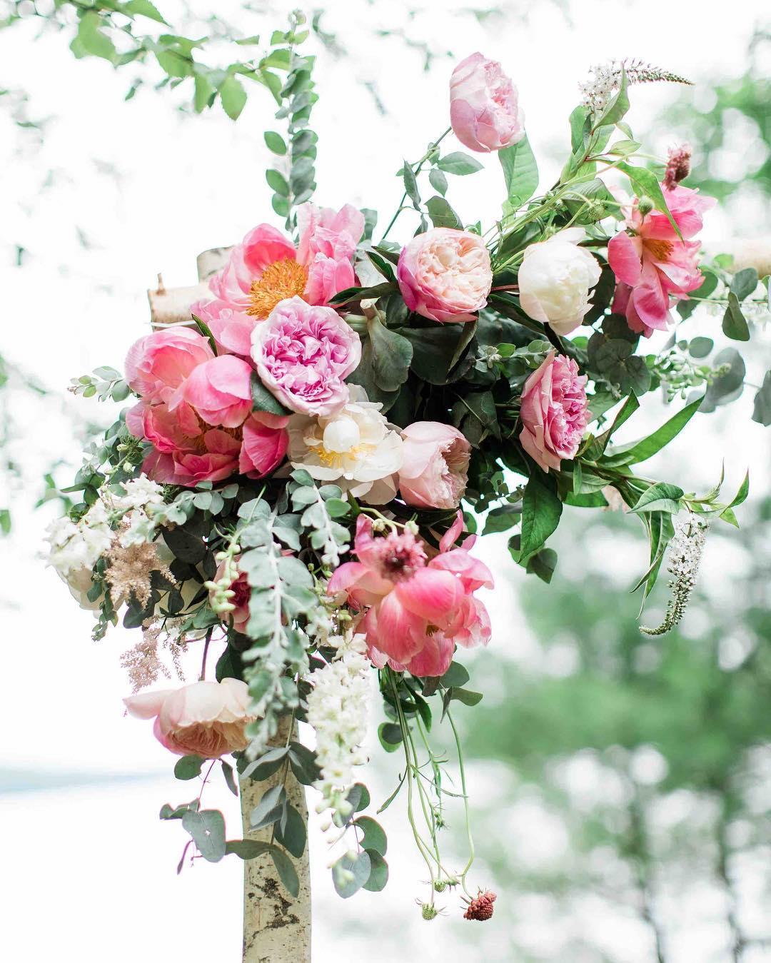 {arbor bling} photo | @jharperphoto  #ceremony #arbor #arborflowers #rusticwedding #woodlandwedding #whitebirch #peonies #pink #coral #gardenroses #lotusfloraldesigns #lovely