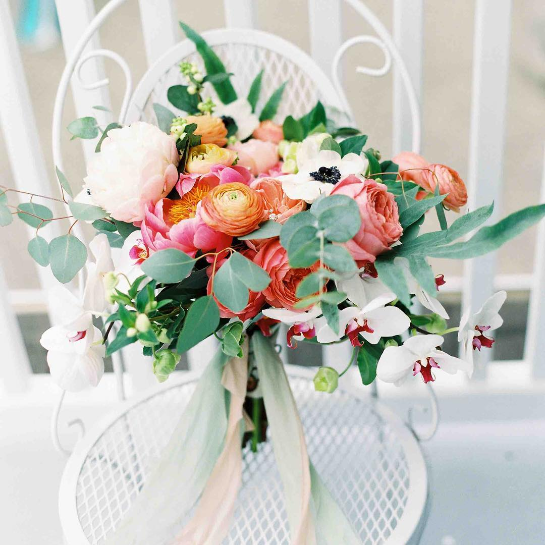 {oh my pretty} photo | @jharperphoto  #gorgeous #bouquet #coral #peach #orchids #peonies #gardenroses #anemones #ranunculus #eucalyptus #handtied #silkribbon #silkandwillow #frenchspoint #coastofmaine #lotusfloraldesigns #weddingflorist #lovemyjob