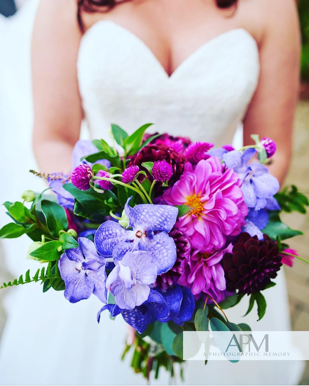 {pretty} photo | @apmnhphoto . . #bouquet #bridebling #accessory #prettyflowers #brideflowers #colorful #purple #blue #magenta #orchids #dahlias #gomphrena #helleborus #lovely #lotusfloraldesigns #weddingflorist