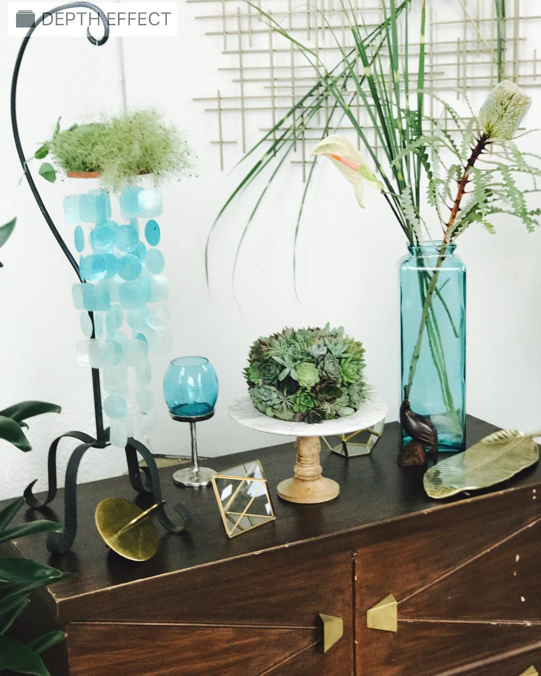 Adding the right piece of furniture can really make a difference in decor. I found this mid-century cedar chest at the Habitat for Humanity retail store and it brings just the right amount of cool to make all the lugging it around worth the effort?? . . #midcenturymodern #caketable #aqua #succulents #succulentcake #decor #getcreative #lotusfloraldesigns #weddingflorist #flowerartist