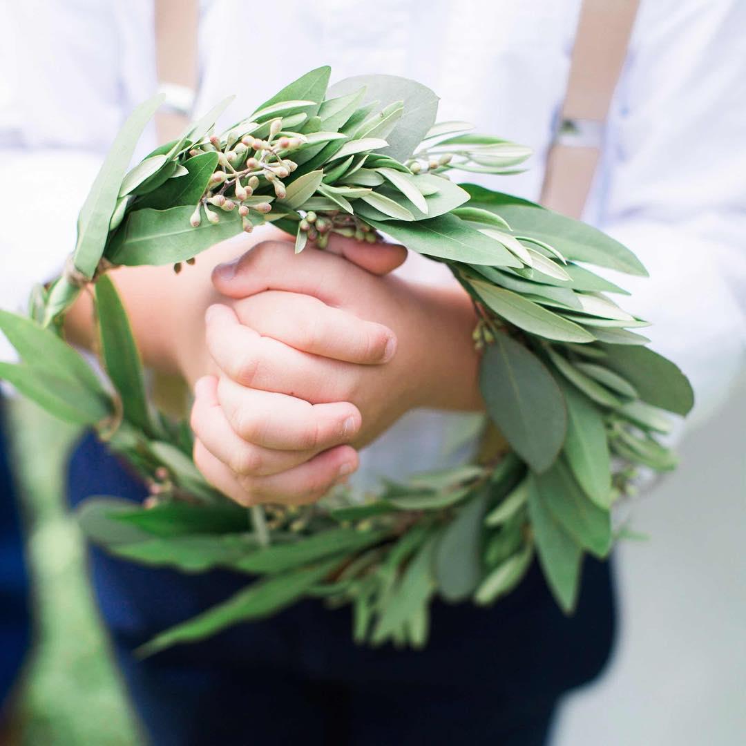 {helper} photo | @jharperphoto . . . #ringbearer #greenery #wreath #adorbs #rustic #barnwedding #nhwedding #cute #eucalyptus #olivebranch #weddingflorist #lotusfloraldesigns