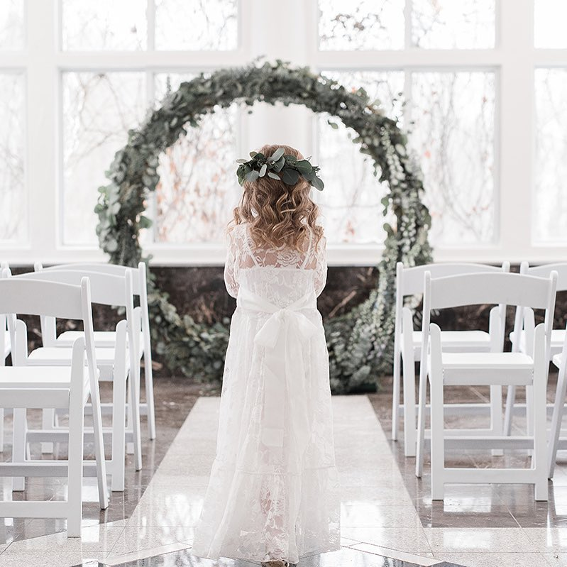 {precious} photo | @klenoxphotography . . . #flowergirl #ceremony #wreath #aisle #backdrop #eucalyptus #winterwedding #herecomesthebride  #lotusfloraldesigns #weddingflowers #weddingflorist
