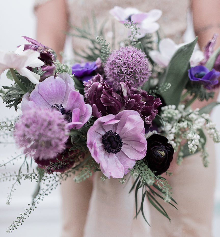 {purples} photo | @klenoxphotography . . . #bride #bouquet #forher #accessory #justmarried #bridebling #flowers #anemones #allium #lilac #love #ranunculus #parrottulips #pennycress #prettyflowers  #lotusfloraldesigns #weddingflowers #weddingflorist