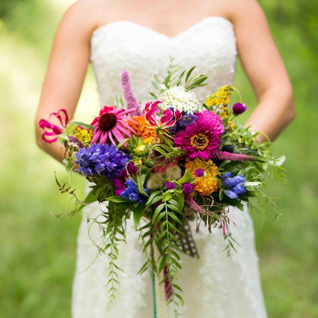 {wildflowers} photo | @alisonmariephotography . . . #color #boho #wildflowers #handtied #zinnia #echinacea #delphinium #gloriosa #natural #bohostyle #prettyflowers #love #lotusfloraldesigns #weddingflowers