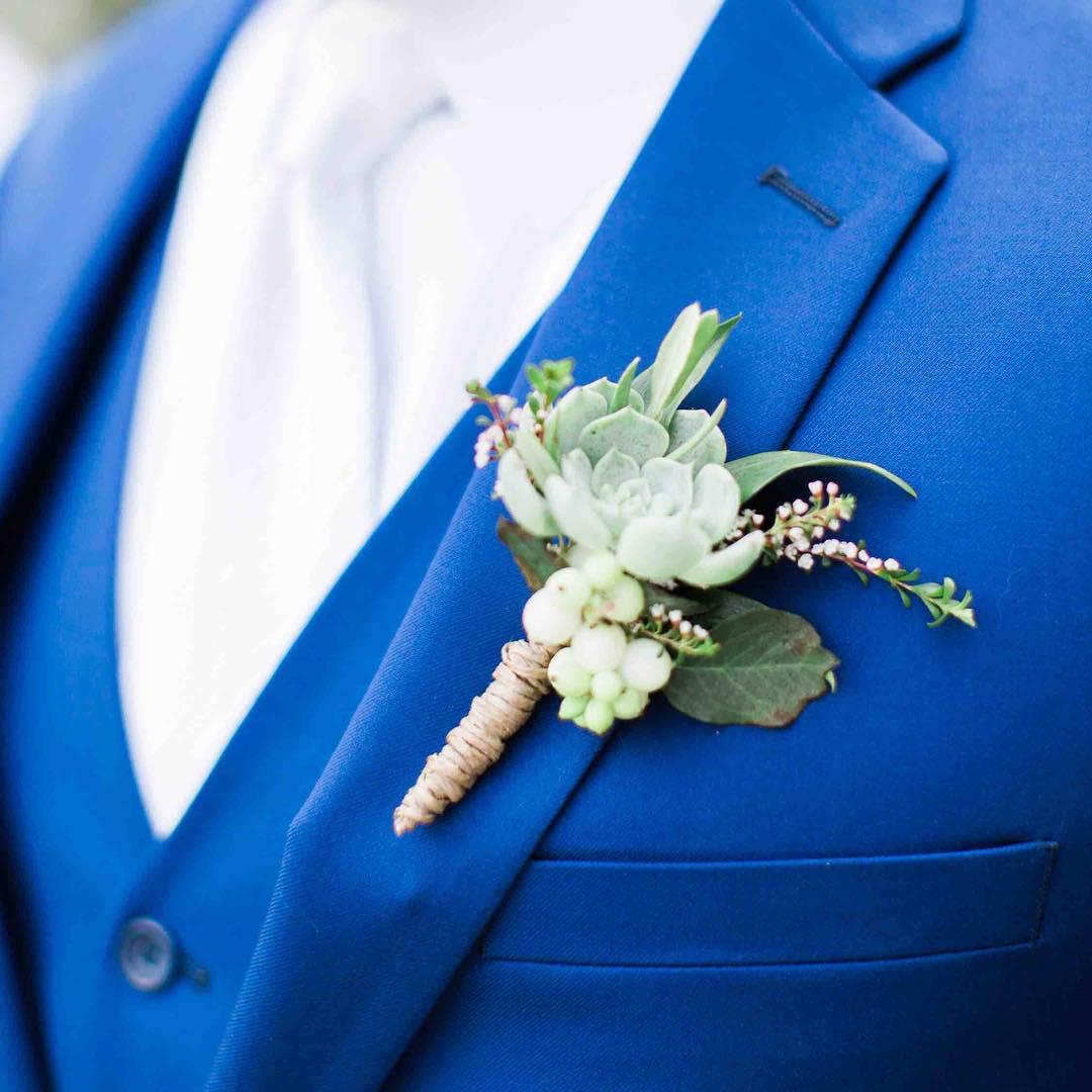 {man-decor} photo | @jharperphoto . . . #manflowers #boutonniere #forhim #manbling #succulents #snowberries #groom #alldressedup #weddingattire  #lotusfloraldesigns #weddingflowers