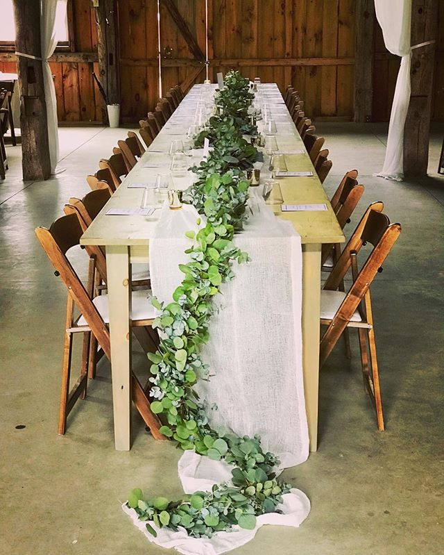 {barn bling} . . #greenery #garland #headtable #rustic #eucalyptus #barnwedding #kitzfarm #nhwedding #lotusfloraldesigns #weddingflowers #weddingflorist #prettyflowers #love