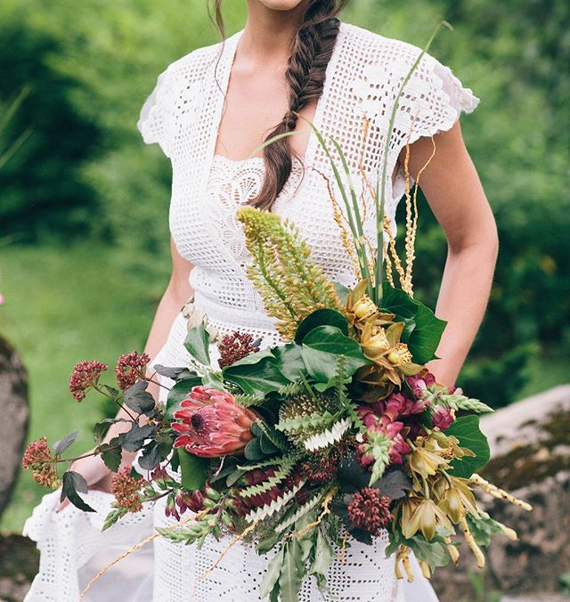 {boho bride} photo | @kate_preftakes . . #boho #bohostyle #bohochic #bouquet #gold #ruby #prettyflowers #protea #customdress #crochet #nontraditional #lotusfloraldesigns #weddingflorist #weddingflowers #styledshoot #getcreative #collaboration