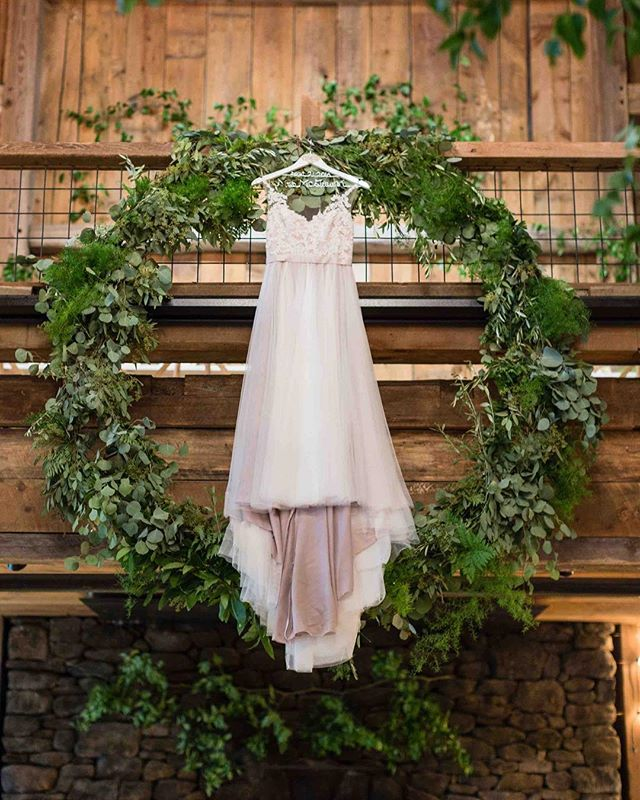 {love•ly} photo | @erikafollansbee  planning & coordination | @nhwedplanner . . #thedress #bride #thebigday #mrandmrs #greenery #greenerywreath #barnbling #barnwedding #nhwedding #rustic #barnonthepemi #lotusfloraldesigns #love