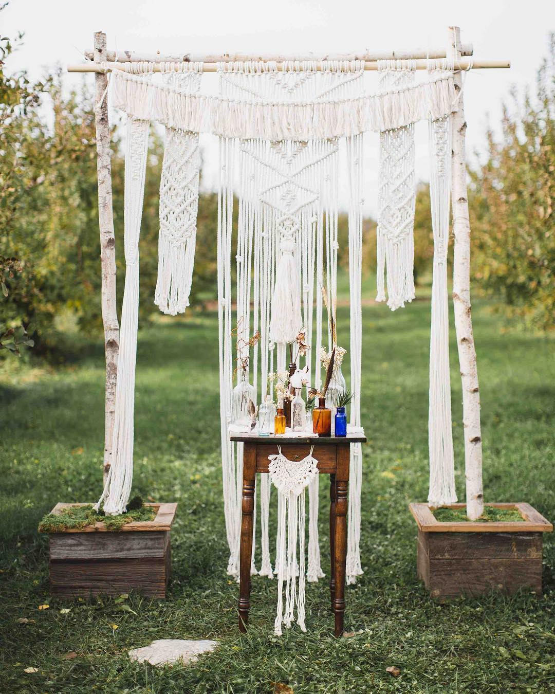 our lotus arbor wearing a custom creation by @rissa.bee ? . {this boho backdrop is available for rental with arbor. contact lotus for more info} . . #boho #bohostyle #macrame #custom #original #interesting #freespirited #arbor #ceremonybackdrop #lotusfloraldesigns #weddingdesign #weddingflorist #love
