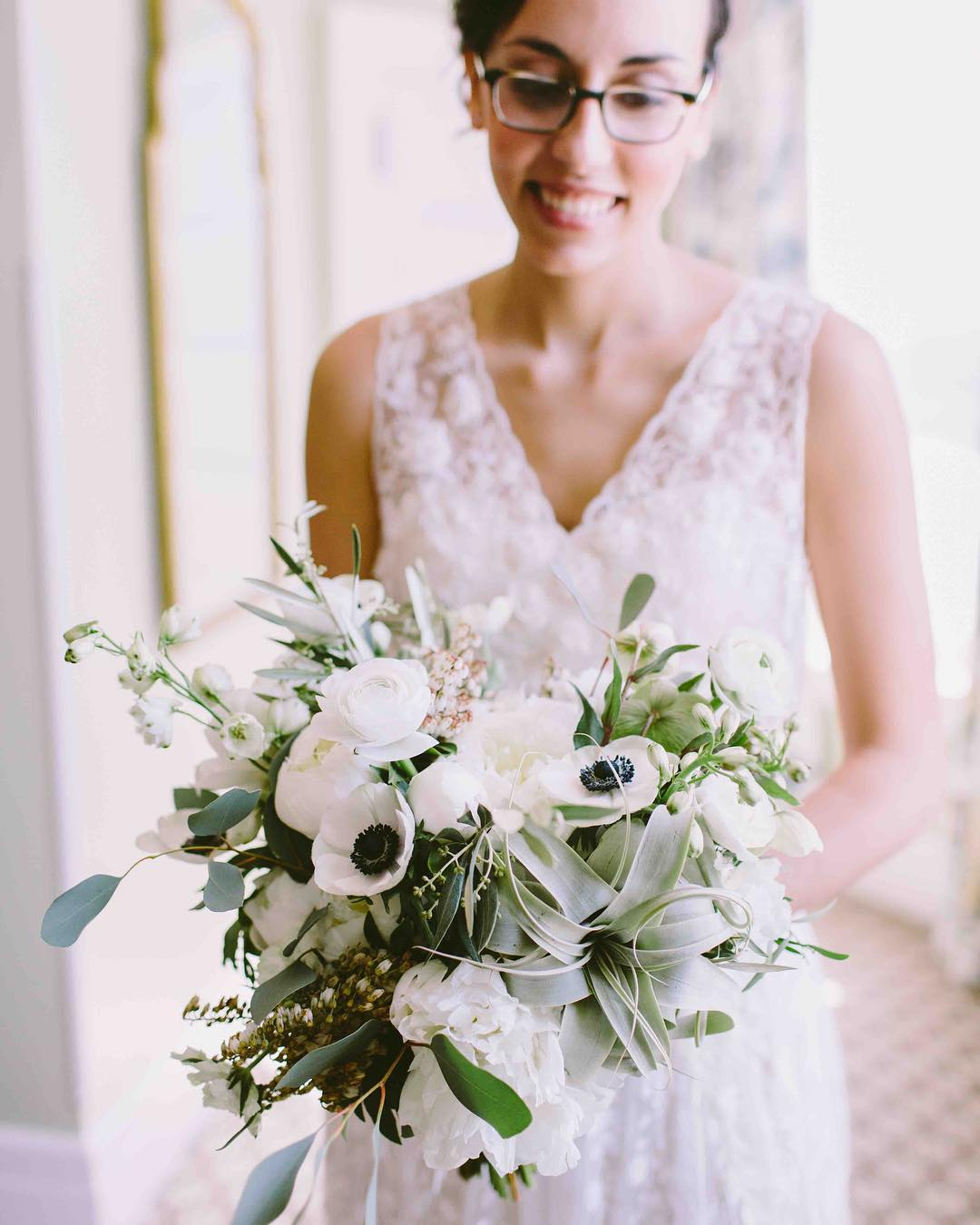 {how cute is she…} photo   @jamiemercuriophoto . . #weddingday #bride #bouquet #accessory #brideflowers #gettingmarried #forever #smilesarecontagious #love #happiness #joy #lotusfloraldesigns #weddingflowers