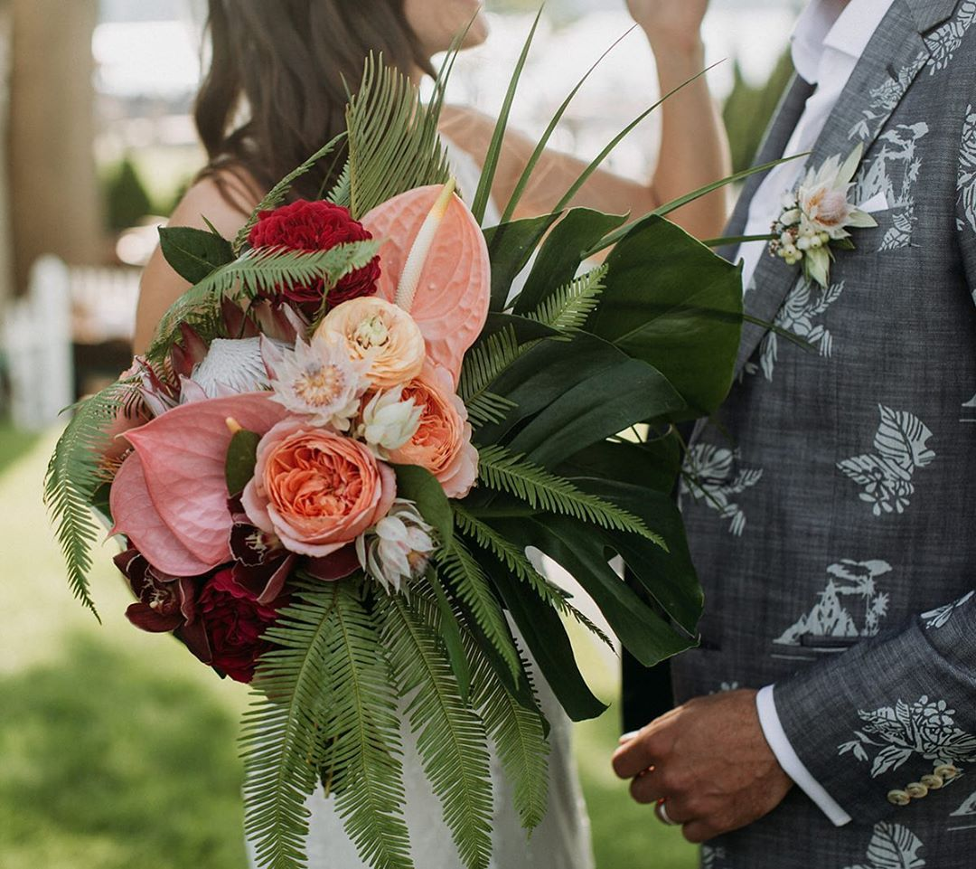 {coolest groom jacket EVER} photo | @ramblefreehannah  coordination | @eventsbysorrell . . #justmarried #hitched #love #bouquet #tropical #bride #groom #attire #weddingdaystyle #stylepoints #bohostyle #lovethis #sweetness #forever #weddingflowers #lotusfloraldesigns #ido