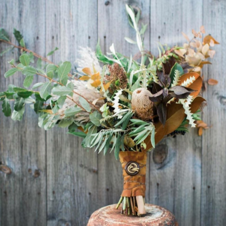 {rustic•pretty} . . photo | @theblakesphotos  design| florals | @lotusfloraldesigns  publication | @lakesregionbride  venue | @lockefallsfarm . . #fall #bouquet #bride #accessory #love #earthtones #protea #greenery #leather #lotusfloraldesigns #ido #weddinginspo