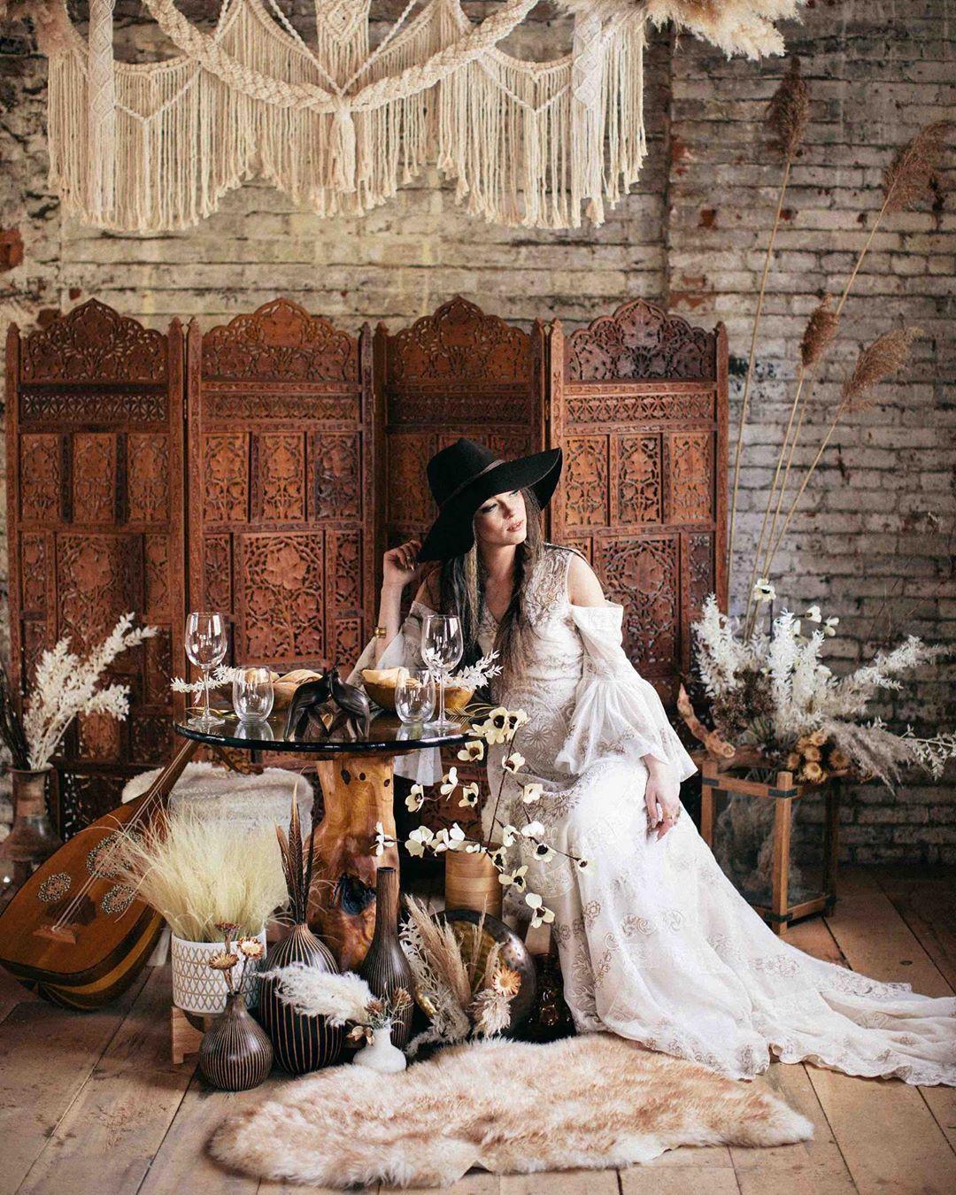 {gypsy• goddess} . . photo & design| @kate_preftakes  florals & design| @lotusfloraldesigns  cake/food & design| @autumnnomad  stationary | @amrcalligraphy  jewelry | @heartofgolddesigns  macrame | @rissa.bee  hair | @jeffreypiroso  makeup| @kmac__beauty  model | @thefreckledmodel  dress | @pamela_moore_bridals . . #gypsy #macrame #warmtones #boho #bohobride #bohochic #gotstyle #cozy #interesting #unique #weddinginspo #love #lotusfloraldesigns #getcreative #portrait