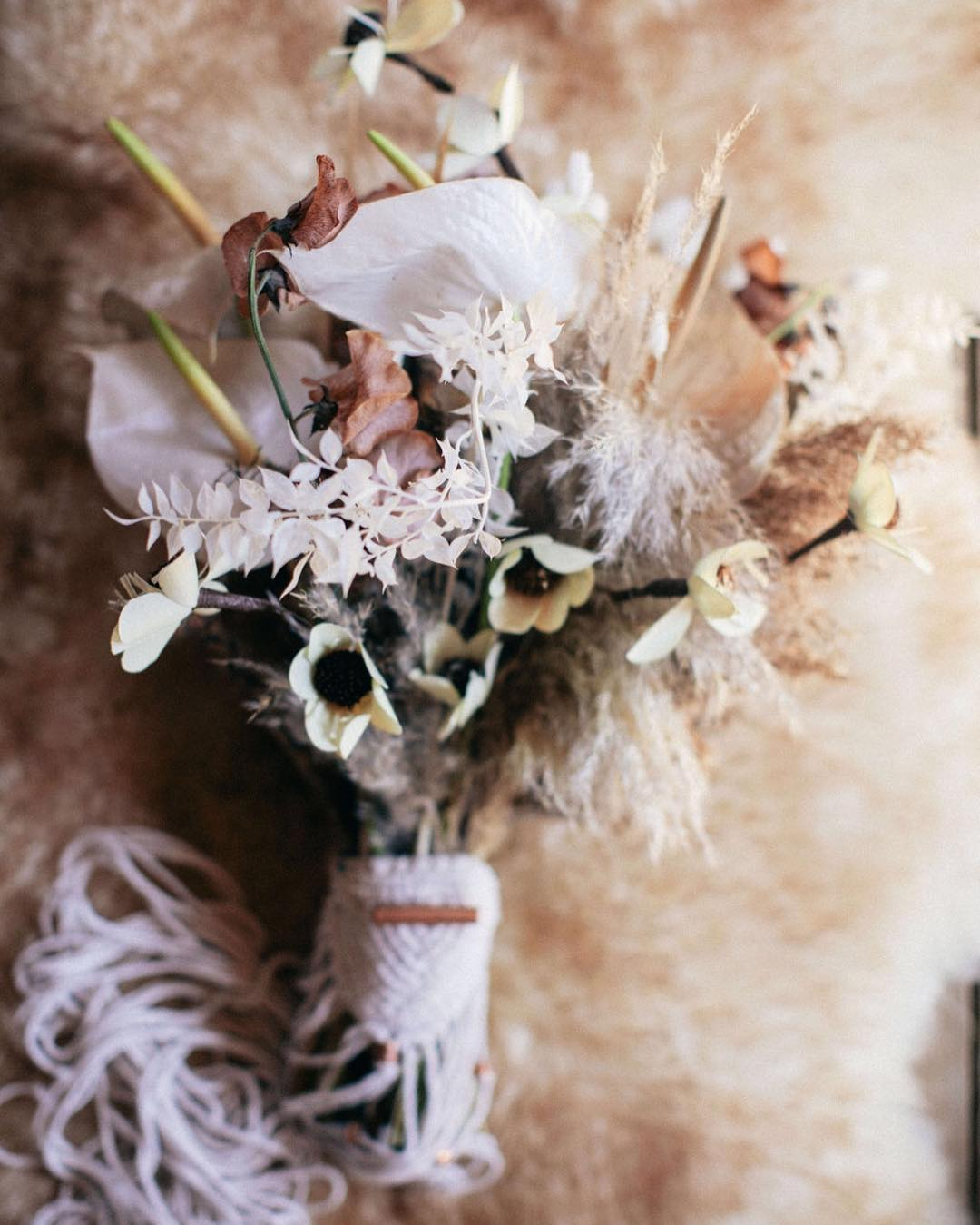 Love combining dried & fresh florals together & for this bouquet I added some paper flowers also & oh yeah and sweet custom macrame wraps by @rissa.bee?? . . Styling/Photography | @kate_preftakes  Styling/Florals | @lotusfloraldesigns  Styling/Cake/Food| @autumnnomad  Macrame | @rissa.bee  Jewelry | @heartofgolddesigns  Dress | @pamela_moore_bridals  Makeup | @katherine_macdonald_beauty  Hair | @jeffreypiroso  Invitations | @amrcalligraphy  Model | @thefreckledmodel . . #collaborate #styledshoot #weddinginspo #weddingdesign #bohostyle #freespirit #moderngypsy #macrame #create #love #makeart #lotusfloraldesigns #oneofakind